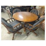 #2561 Oak Round Table w/ 1 leaf and 5 rolling arm chairs