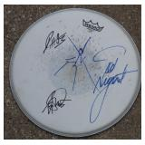 Snare head signed by Ted Nugent and others