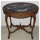 #266 Heavily carved Parlor Table with Marble Top