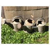 Old farm watering cans