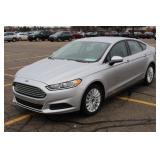 UM# 0396  2016 Ford Fusion Hybrid w/ 17,402 Miles