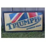Triumph Authorized Dealer sign in frame