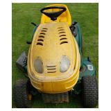 Yard Man Riding Lawnmower