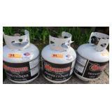 Trio of Gas Propane Barbeque Tanks