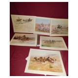 TWO SETS OF CHARLES RUSSELL ART PRINTS IN FOLDERS
