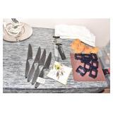 4 KUHN RIKON STEAK KNIVES, LUCITE NAPKIN RINGS,