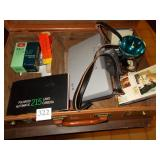 LEATHER BRIEFCASE WITH VINTAGE POLAROID CAMERA,
