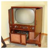 PHILCO TV W/ TURNTABLE AND RECORDS