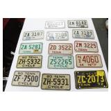 GROUPING: 14 MOTORCYCLE LICENSE PLATES MOST ARE