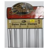 2 GATES ADVERTISING ITEMS: TIN SIGN AND HOSE