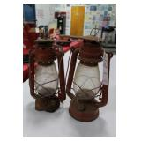 2 RED BARN LANTERNS 1 DAMAGED AROUND BASE