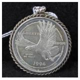 1994 SILVER DOLLAR WITH STERLING BEZEL - NATIONAL