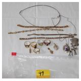 BAG OF ASSORTED SLIVER RINGS, NECKLACE AND