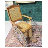 Cane seat vintage wheelchair