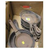 Lot, 10 small iron pans and 1 steel pan