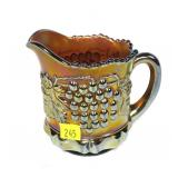 Northwood grape and cable Carnival glass pitcher,