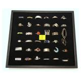 36- Sterling silver rings, including a black and