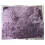 High end purple shag area rug made by Surya