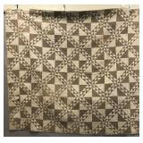 Brown calico material quilt ca. 1840