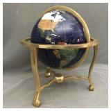 Semi presious stone World globe on brass base