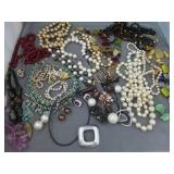 Large lot of costume jewelry necklaces, bracelets
