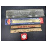 5 measuring devices - ruler, tape measure, and
