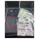 2 stethoscopes and informational guides