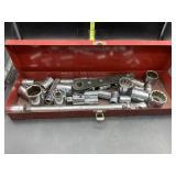 Sockets in metal red toolbox
