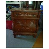 Nice carved 3 drawer ended table. Bottom drawer