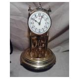 Mechanical brass clock. Good shape. Glass dome