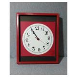 Wooden frame Wall clock. Battery operated and