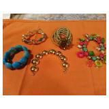 5 Assorted Fashioned bracelets. MONET gold tone