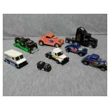 Assortment of vehicles. Cars, and trucks.