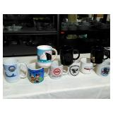 9 Assorted Coffee mugs.