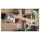 Contents of wall board including electrical tape