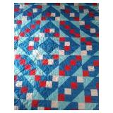 "93"" × 83"" blue based machine quilted quilt"