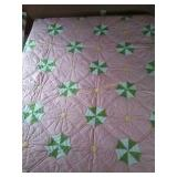 "92""×90"" pink and green machine quilted quilt"