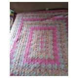 "94""×102"" predominantly pink machine quilted quilt"