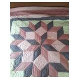 "85""×87"" machine quilted quilt pinks and mauves"