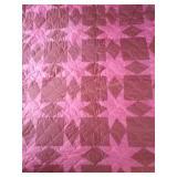 "102""×95"" pink machine quilted quilt"