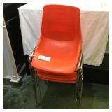 4 Orange Hard Plastic Chairs