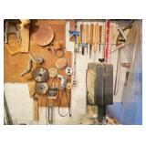Woodworking Tools & Saw Blades Hanging on Wall