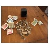 Mini metal bank with large lot of foreign money