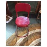 Vintage red metal shop stool
