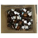 Box full of mini amber chemical bottles
