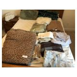 Large lot of bedding & rugs