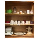 Shelves full of coffee mugs, plates & more