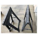 Pair of plastic saw horse stands