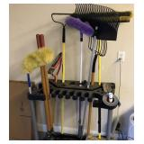 Rack and garden tools brooms etc