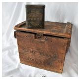 Antique wooden egg crate and tea tin